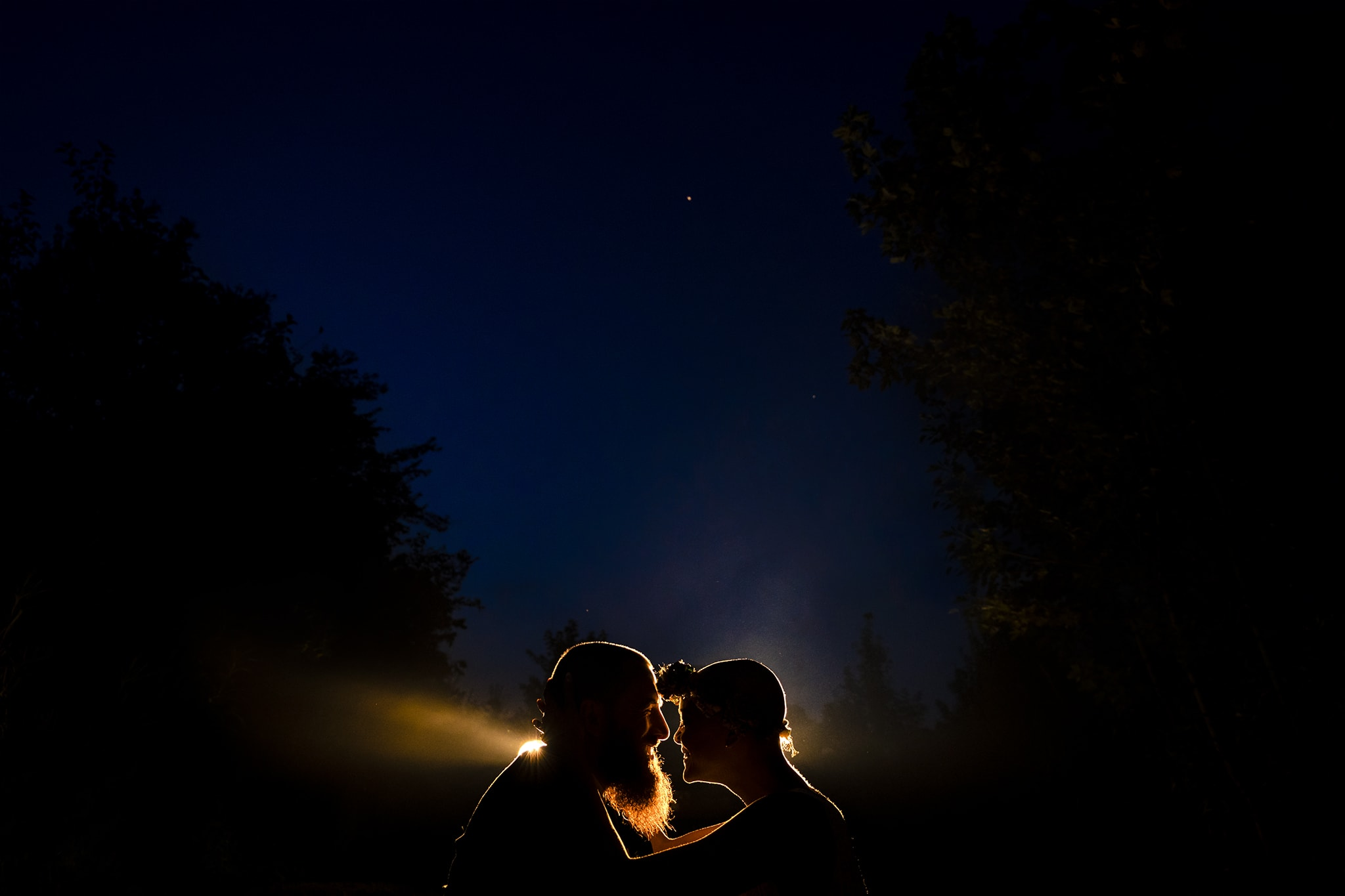 Bride and groom sit together after their intimate elopement, silhouetted against the night sky in Cincinnati, Ohio by Studio 22 Photography
